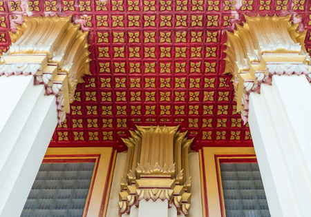 Golden flower pattern in the traditional Thai style on the ceiling of the Thai church.(Public area not required Property Release)