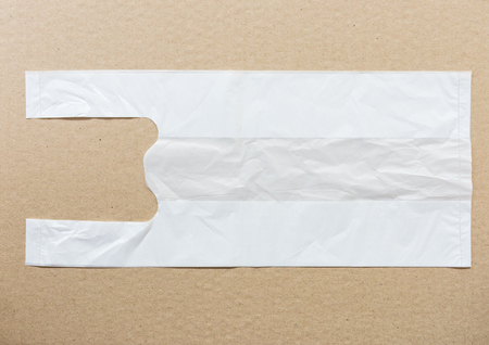 packing paper: white plastic bag for use in the grocery shop on the packing paper. Stock Photo