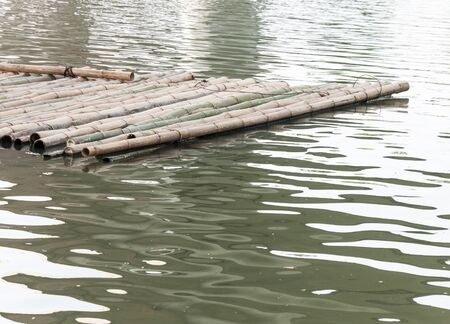 Old bamboo raft is floating on the lake of the national park.