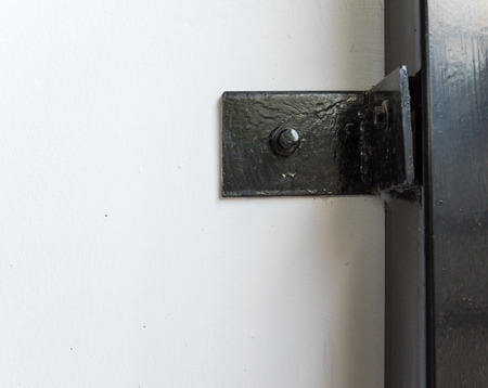 elbow brace: Black metal brace for lock the steel pole with house wall. Stock Photo