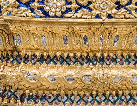 gloden: Gloden flower pattern with glass mosaic on the church wall in the Thai temple. (Public area not required Property Release) Stock Photo