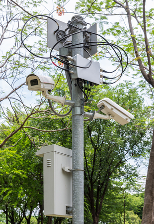 lens unit: New cctv set with the connection unit on the metal pole in the urban park. Stock Photo