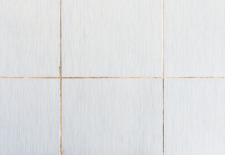 Old tile wall with the dirty grout in the kitchen of the urban house. Stock Photo