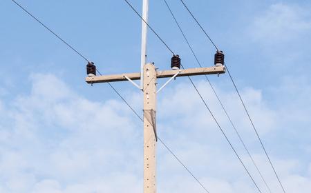 Concrete eletric pole under the blue sky near locate the rural area in Thailand. Stock Photo