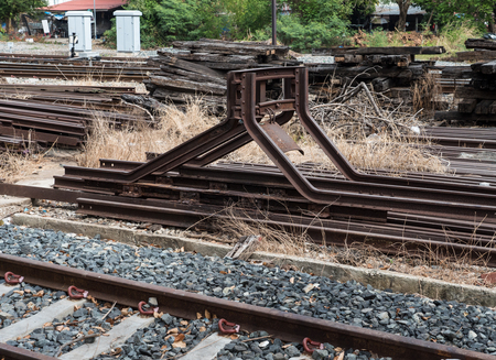buffers: Steel buffers stop in the end of the railway at the junction of the local railway station. Editorial