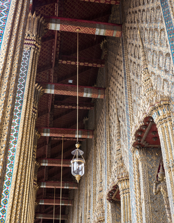 Luxury electric lamp is hanging on the ceiling of the church around the terrace in the Thai temple.