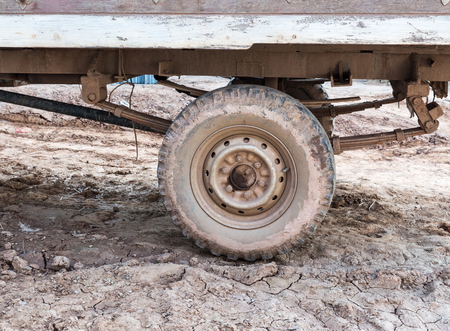 Dirty wheel of the local small truck for use in the country farm,Thailand. Stock Photo