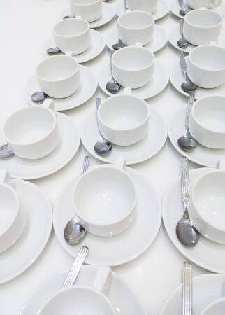 Row of the coffee cup with the tea spoon for coffee break in the conference event.
