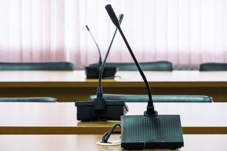 Modern microphone for conference time in the meeting room of the business center.