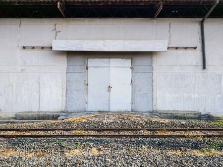 Old warehouse for storage of goods from the freight train in the urban station.