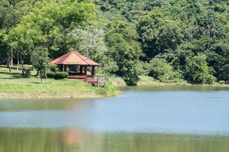 Small pavilion with the terrace near the reservoir in the valley of the national park.