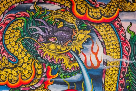 fale: Dragon sculpure and fish one the shrines of Thailand Editorial