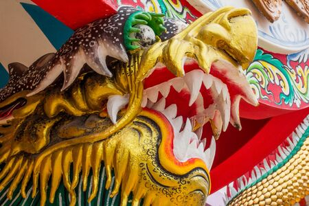 fale: Dragon sculpure and fish one the shrines of Thailand Stock Photo