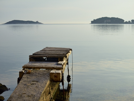 Old wooden pier in island of Vis, Croatia, Adriatic sea          photo