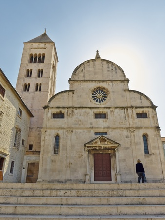 11th century: woman in front of church of St  Mary, Zadar, Croatia