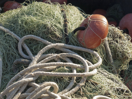 toils: old fishing net with buoys in the port