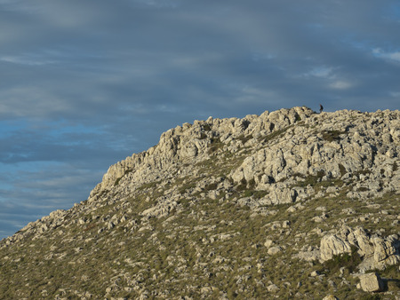 kornat: climber in the distance, climbing the hill on the island of Kornat
