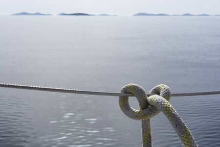 lifeline: Mooring rope tied around a lifeline with clove hitch
