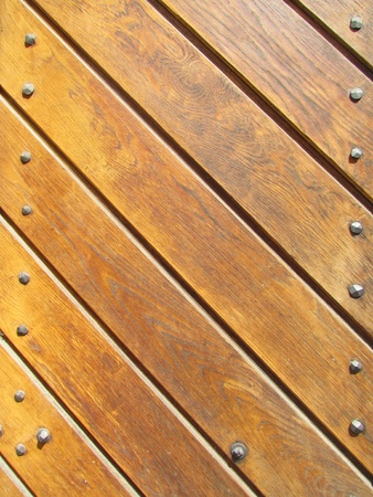 studs: Wood slat background with metal studs