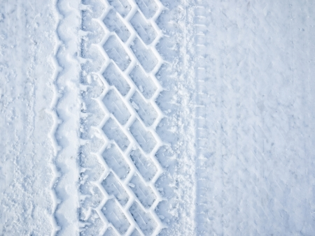 Car wheel tire track in snow photo