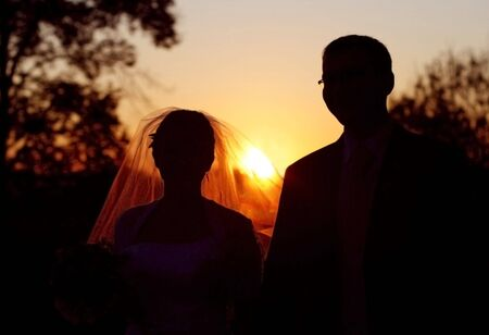 fidelity: young couple in on background of sunset Stock Photo
