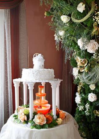 White wedding cake with white frosting among roses. Stock Photo - 3199659