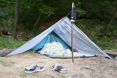 survival and bivouac on open air, provisional tent Stock Photo