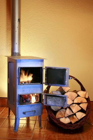 log basket: Old fashioned wood burning stove
