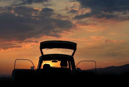 Trabant car on background sunset