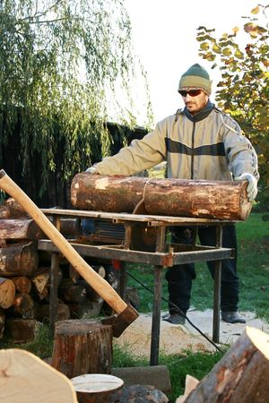 Cutting of wood on winter, supply Stock Photo - 4392729