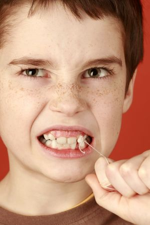lost healthy milk-tooth, young tough boy pulling a tooth out, piercing toothache Stock Photo