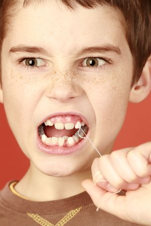incisor: determination young boy, extraction milk tooth, lost healthy milk-tooth, young tough boy pulling a tooth out, piercing toothache