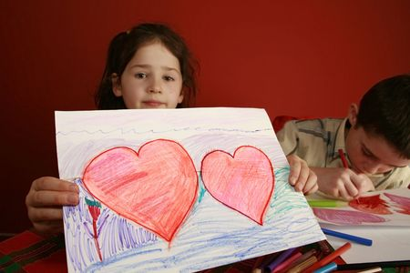 hand-made valentine card of school children drawing hearts instead of doing homework photo