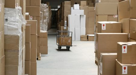 overproduction: warehouse corridor and handcart, carton stock