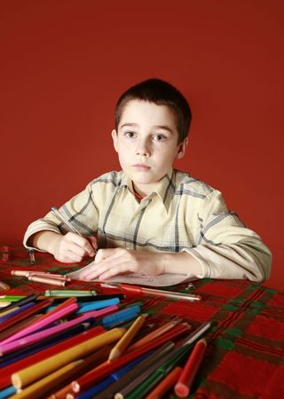musing: freckled boy musing and drawing Stock Photo
