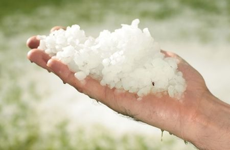 hail: hail after storm on grass, pea sized hail fell on meadow, many hail on hand
