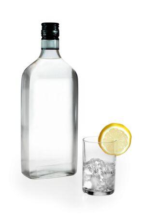 blank label vodka glass and lemon on white background