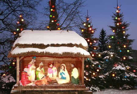 christendom: Night shot of a Nativity Scene, Three Kings bow, Three Wise Men Stock Photo