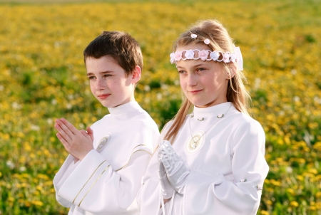 conscience: children portrait in first holy communion, praying hands, rite of passage, clear conscience
