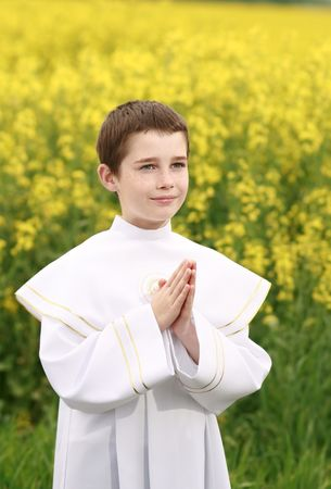 child in first holy communion, purity conscience, praying hands Stock Photo
