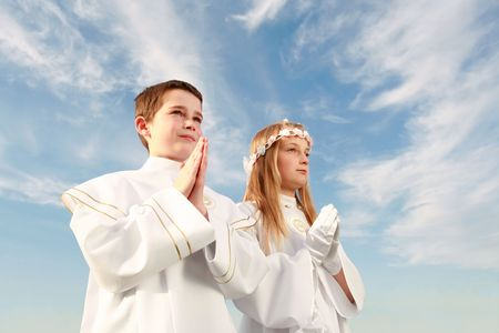 boy and girl in first holy communion, purity conscience, praying hands