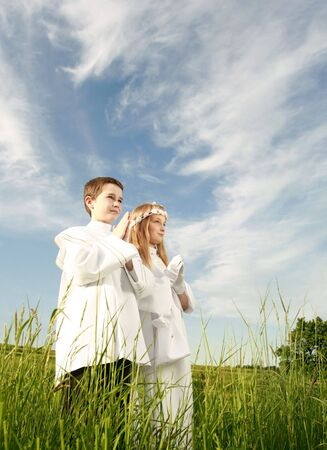 conscience: boy and girl in first holy communion, purity conscience, praying hands