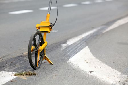 Meter measuring wheels, used to measure distance. Used by police for accident footage Stock Photo