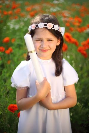 Girl child portrait (9-10) in his first holy communion, praying hands, rite of passage, clear conscience