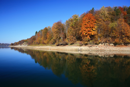 Solina Lake is an artificial lake in the Bieszczady Mountains region in Poland. It is Polands largest man-made lake called also Bieszczady Sea. This reservoir was created by the construction of the Solina Dam on the San River.