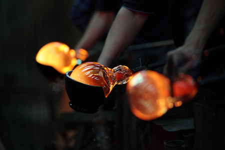 Process of shaping glass during handmade production Stock Photo
