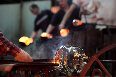 Teamwork in glass factory – forming