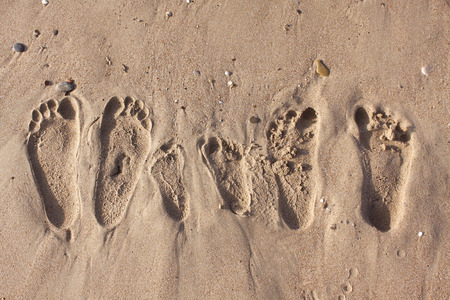 Family footprints on the sand beach in Side Turkey