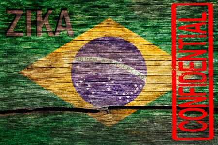 Brazil flag painted on the old cracked wood with word zika and confidential warning before the virus infection