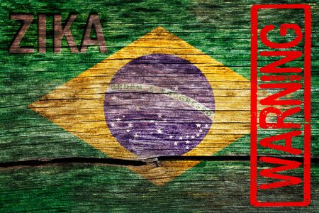 Brazil flag painted on the old cracked wood with word zika and warning alert the virus infection risk 版權商用圖片